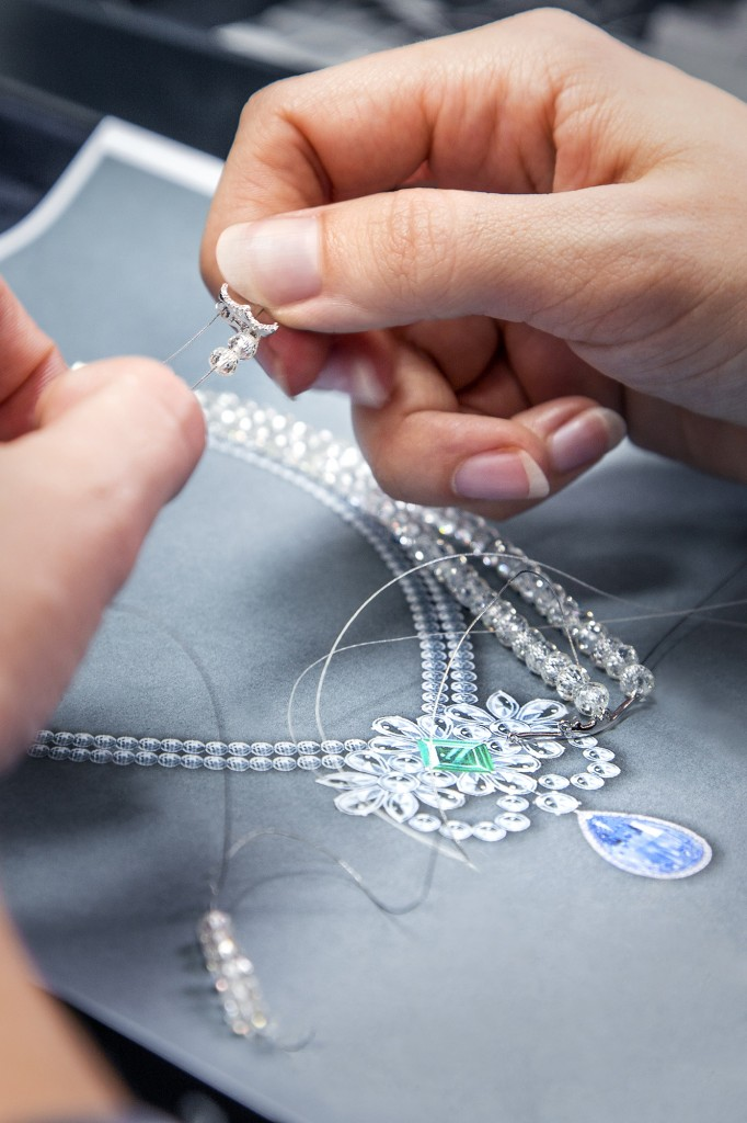 Delicate diamond beads are threaded to form the necklace of Le Collier Bleu de Reve